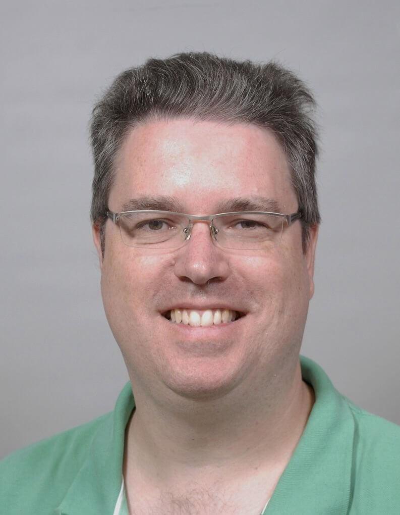 KBenP medewerker John Compton